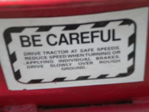 All tractors should have this rather severe warning.  Remember, BE CAREFUL!!!